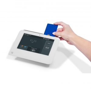 Image of a hand inserting a blue chip card into a Clover Mini point-of-sale equipment from Monify.