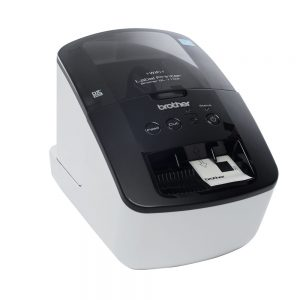 Image of a large, black and gray Clover Label Printer payment solution printing a ticket.