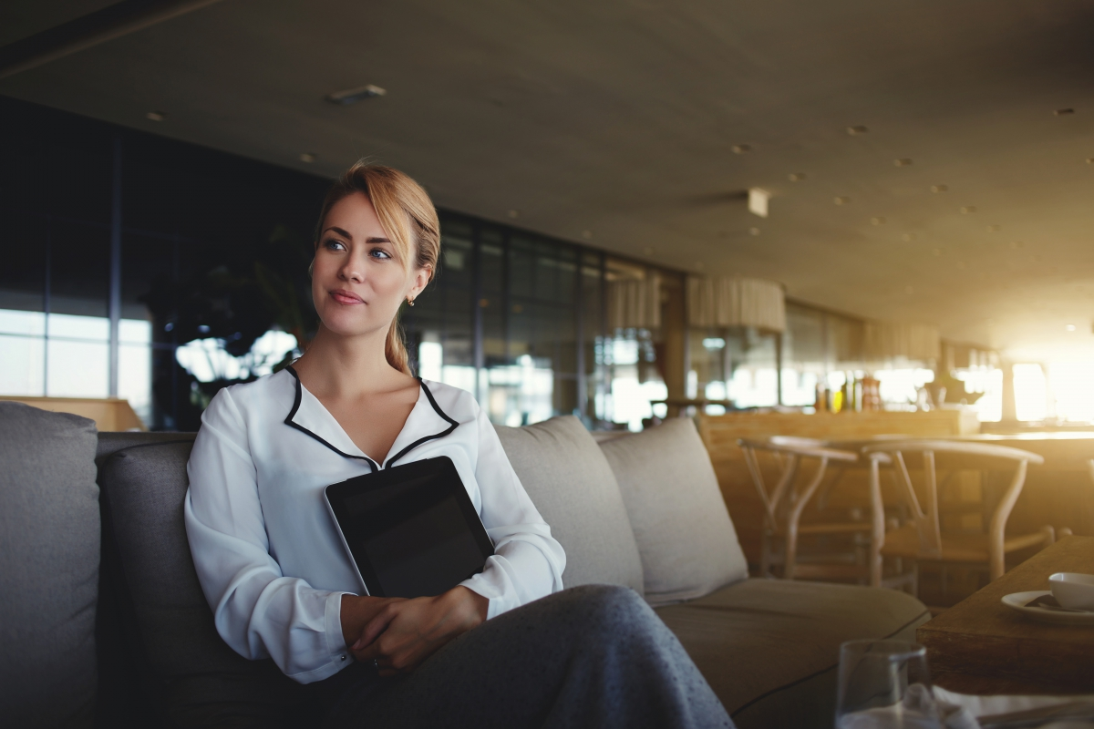Woman luxury coffee shop owner with digital tablet